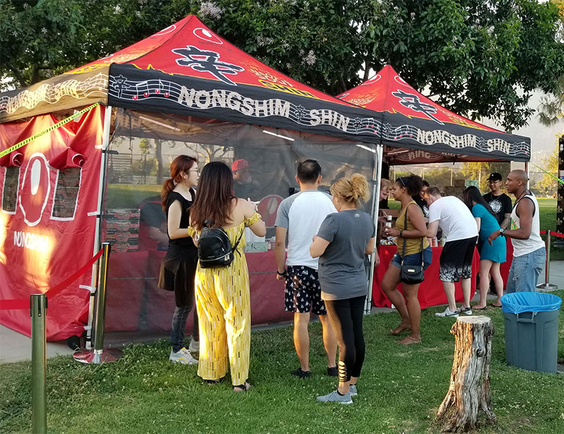 People gathering in front of the Nongshim Popup Event Tent